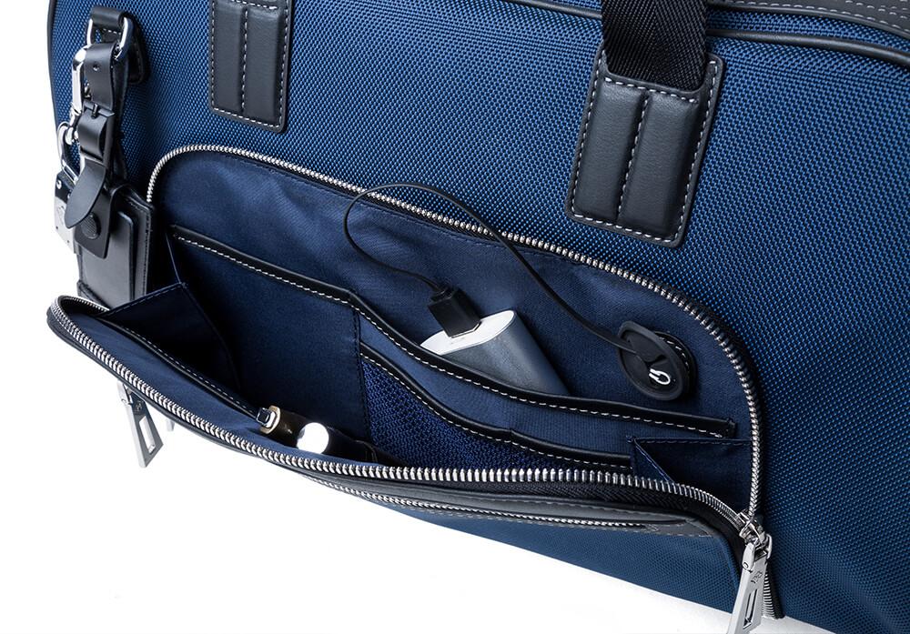 JMNY Atlas travel bag in navy blue front hidden pocket
